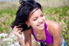 Beautiful caribbean woman posing. On a tropical beach Stock Image