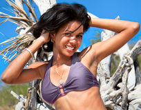 Beautiful caribbean  woman on tropical beach Stock Photos