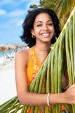 Beautiful caribbean woman under pal. Beautiful caribbean woman sunbathing under the palm on a Caribbean island Stock Image