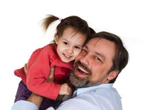 Beautiful caring daddy holding his daughter Stock Images
