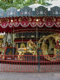 Beautiful carousel for kids in amusement park Stock Photos