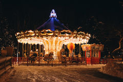 Beautiful carousel in park at night in winter Stock Photo
