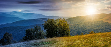 Beautiful Carpathian panorama time concept. Time and day change concept. beautiful panorama of Carpathian mountains in early autumn weather. few beech tree tops Royalty Free Stock Images