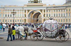 Beautiful carriage on Palace Square. People in carriage at Palace Square near Winter Palace of St. Petersburg. Summer 2016. Stock Images
