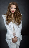 Beautiful carroty woman in a white jacket Royalty Free Stock Images