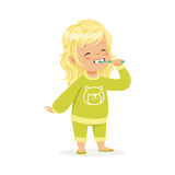 Beautiful cartoon blonde girl in a green pajamas brushing her teeth, kids dental care vector Illustration Stock Image