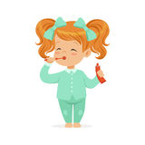 Beautiful cartoon redhead girl in a light blue pajamas brushing her teeth, kids dental care vector Illustration Stock Photography
