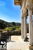 Carved stone arcades and columns of Monserrate palace in Sintra. Beautiful carved stone arcades and columns of Monserrate palace in Sintra, Lisbon, Portugal royalty free stock photography
