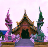 The beautiful carved wood chapel,Chiangmai,Thailand. Thailand,May 28,2017:Beautiful carved wood chapel at Wat Ban-den Am-phoe Matang Chiangmai province.This Stock Photo