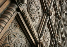 Beautiful carved wooden door. Detail from a beautiful wooden carved door of a church Royalty Free Stock Image
