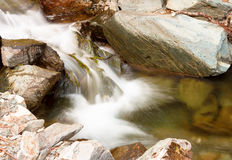 Beautiful cascade through mountain rocks Royalty Free Stock Image