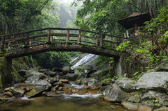 Beautiful cascaded river flowing through with bridge and waterfall Royalty Free Stock Photos