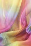 Beautiful Cascading Chiffon Background. Beautiful rainbow colored chiffon material cascading in gentle folds Royalty Free Stock Photo