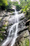Beautiful cascading full-flowing waterfall Stock Image