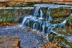 Beautiful cascading waterfall in High Dynamic Range Stock Photography