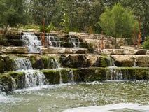 Beautiful cascading waterfall over rocks Royalty Free Stock Photos