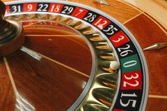 Beautiful casino roulette close-up with playing chips royalty free stock photo
