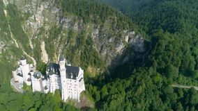 Beautiful Castle Alps Neuschwanstein Aerial 4k. Aerial footage of a beautiful castle in the Bavarian alps in Germany called Neuschwanstein. This is in 4k quality stock video footage