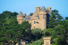 Beautiful castle among green trees Royalty Free Stock Images