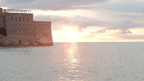 Beautiful castle located in picturesque area, on island in middle of sea stock footage