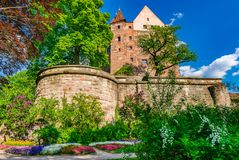 Beautiful castle of the medieval old Kaiserburg in Nuremberg, Germany. Old historical Kaiserburg in Nuremberg, with surrounding wall and beautiful castle garden stock photo