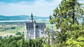 Beautiful Castle Neuschwanstein Valley View Timelapse 4k. Timelapse footage of a beautiful castle in the Bavarian alps in Germany called Neuschwanstein. This is stock video footage