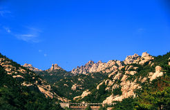 The beautiful castle peak under the blue sky. The natural scenery, the sunny sky, beautiful green hill, green vegetation, rugged mountains, rocks with different Stock Photos