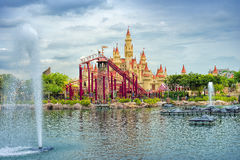 Beautiful castle and roller coaster Stock Images