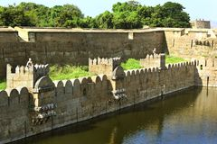 Beautiful castle wall and battlements with trench. Fort battlements and wall with trench at Vellore fort is a 16th-century fort situated in the Vellore city, in Royalty Free Stock Photos