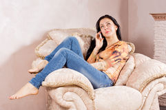 Woman listening to a call on her mobile Stock Photos