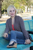Beautiful Casual Blonde on a Park Bench (1) Stock Images