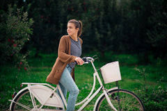 Beautiful casual girl with a bicycle Stock Photography