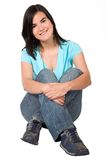 Beautiful casual girl sitting down Stock Photo