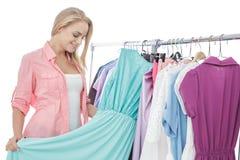 Beautiful casual woman choosing long dress at store Royalty Free Stock Photos
