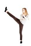 Beautiful casual woman doing a kick. Stock Photography