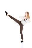 Beautiful casual woman doing a kick. Stock Image