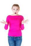 Beautiful casual woman expresses shock. Stock Photo