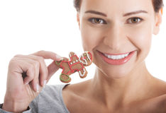 Beautiful casual woman with gingerbread christmas cookies. Stock Photos