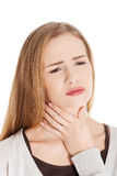 Beautiful casual woman is having sore throat. Royalty Free Stock Photo