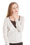 Beautiful casual woman is having sore throat. Royalty Free Stock Photos