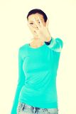 Beautiful casual woman with her hand in front. Royalty Free Stock Image