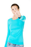 Beautiful casual woman with her hand in front. Stock Photography