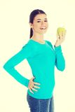 Beautiful casual woman holding an apple. Stock Photography