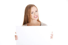 Beautiful casual woman holding copy space and advertising. Stock Photos