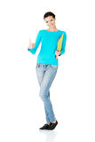 Beautiful casual woman holding  files and showing OK. Royalty Free Stock Image