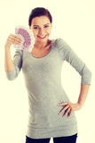 Beautiful casual woman holding money. Royalty Free Stock Images
