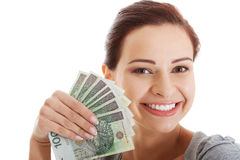 Beautiful casual woman holding money. Royalty Free Stock Photos
