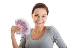Beautiful casual woman holding money. Stock Images