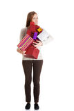Beautiful casual woman holding presents in boxes. Stock Photography