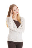 Beautiful casual woman looks worried. Royalty Free Stock Image